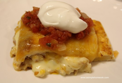 chicken and cheese enchilada topped