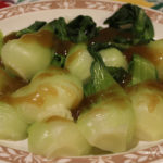 baby bok choy on platter with sauce